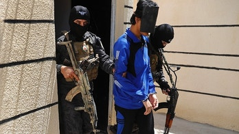 FILE - In this file picture taken on Friday, July 21, 2017, Kurdish soldiers from the Anti-Terrorism Units, carry a blindfolded an Indonesian man suspected of Islamic State membership, at a security center, in Kobani, Syria. Western governments have tacitly handed down guidance to the forces uprooting the remnants of Islamic State in Raqqa and beyond on how to handle their citizens who joined the extremist group by the thousands. (AP Photo/Hussein Malla, File)