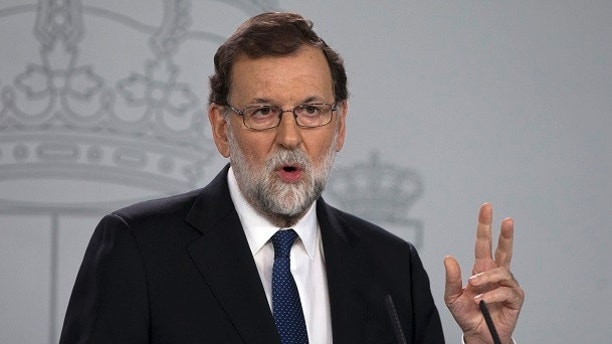 Spain's Prime Minister Mariano Rajoy speaks during a news conference at the Moncloa Palace in Madrid, Spain, Saturday, Oct. 21, 2017. The Spanish government moved to activate a previously untapped constitutional article Saturday so it can take control of Catalonia, illustrating its determination to derail the independence movement led by separatist politicians in the prosperous industrial region. (AP Photo/Paul White)