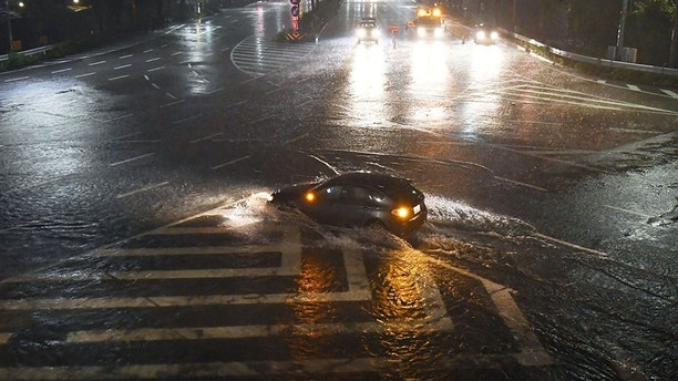 Water-covered road caused by heavy rains by Typhoon Lan is seen in Nagoya, Japan, in this photo taken by Kyodo October 22, 2017. Mandatory credit Kyodo/via REUTERS ATTENTION EDITORS - THIS IMAGE WAS PROVIDED BY A THIRD PARTY. MANDATORY CREDIT. JAPAN OUT. NO COMMERCIAL OR EDITORIAL SALES IN JAPAN. - RC127A697000