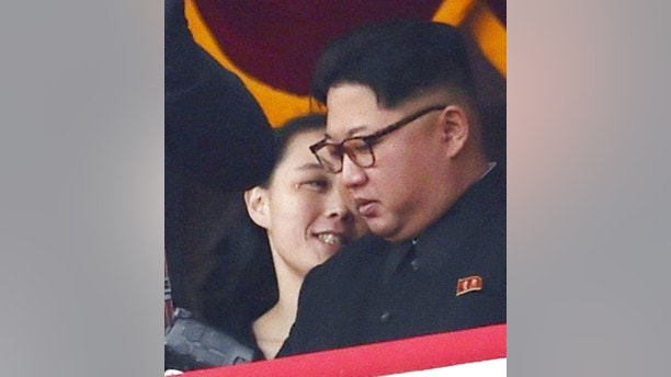 In this May 10, 2016, photo, North Korean leader Kim Jong Un, right, and his sister Kim Yo Jong watch a military parade at Kim Il Sung Square in Pyongyang. Kim Jong Un has promoted his younger sister to a new post within North Korea's ruling party. The promotion of Kim Yo Jong came at a meeting of the party as North Korea marked the 20th anniversary of the late Kim Jong Il's acceptance of the title of general secretary of the ruling Worker's Party of Korea.  (Minoru Iwasaki/Kyodo News via AP)