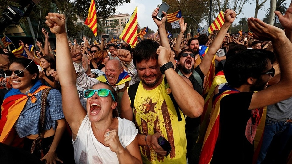 Pro-independence Catalan celebrate outside the Parliament after lawmakers voted to declare the region's independence from Spain.