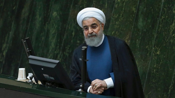 Iranian President Hassan Rouhani defends his proposed ministers of energy and science in an open session of parliament, in Tehran, Iran, Sunday, Oct. 29, 2017. Parliament approved Reza Ardakanian to work as energy minister and Mansour Gholami as minister of science who is in charge of higher education and universities, completing Rouhani's 18-minister cabinet. (AP Photo/Vahid Salemi)