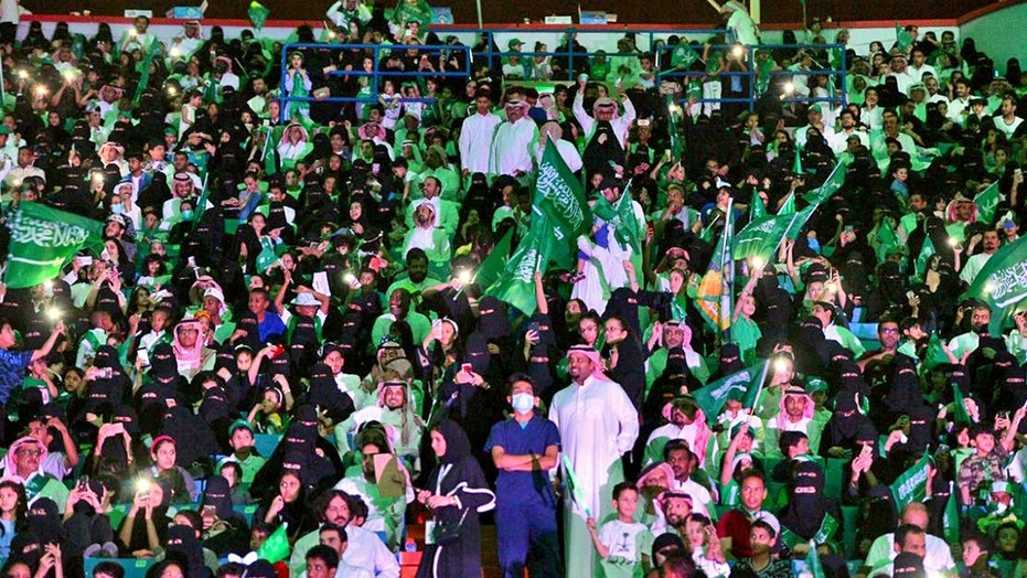 Saudi men and women attend national day ceremonies at the King Fahd stadium in Riyadh.
