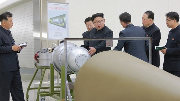 North Korean leader Kim Jong Un provides guidance with Ri Hong Sop (2nd L) and Hong Sung Mu ( 2nd R) on a nuclear weapons program in this undated photo released by North Korea's Korean Central News Agency (KCNA) in Pyongyang September 3, 2017.  KCNA via REUTERS    ATTENTION EDITORS - THIS PICTURE WAS PROVIDED BY A THIRD PARTY. REUTERS IS UNABLE TO INDEPENDENTLY VERIFY THE AUTHENTICITY, CONTENT, LOCATION OR DATE OF THIS IMAGE.  NOT FOR SALE FOR MARKETING OR ADVERTISING CAMPAIGNS. NO THIRD PARTY SALES. NOT FOR USE BY REUTERS THIRD PARTY DISTRIBUTORS. SOUTH KOREA OUT. NO COMMERCIAL OR EDITORIAL SALES IN SOUTH KOREA. THIS PICTURE IS DISTRIBUTED EXACTLY AS RECEIVED BY REUTERS, AS A SERVICE TO CLIENTS. - RC173054AEE0