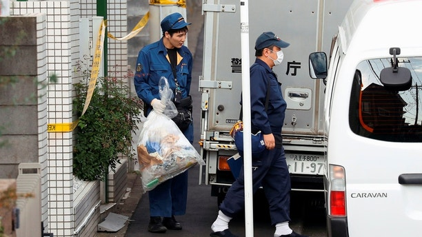 A police officer carries out a plastic bag from an apartment building where media reported nine bodies were found in Zama, Kanagawa Prefecture, Japan in this photo taken by Kyodo on October 31, 2017. Mandatory credit Kyodo/via REUTERS ATTENTION EDITORS - THIS IMAGE WAS PROVIDED BY A THIRD PARTY. MANDATORY CREDIT. JAPAN OUT. NO COMMERCIAL OR EDITORIAL SALES IN JAPAN. - RC12278E5730