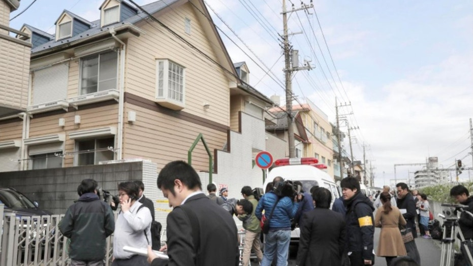 Members of the media gather in front of an apartment building where nine bodies were reportedly found in Zama, Kanagawa Prefecture, Japan.