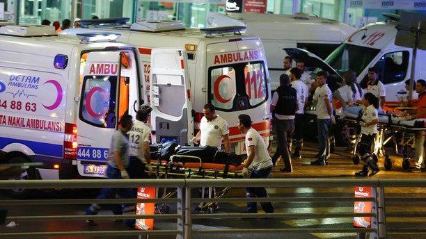 Paramedics push a stretcher at Turkey's largest airport, Istanbul Ataturk, Turkey, following a blast June 28, 2016.     REUTERS/Osman Orsal - LR1EC6S1KSILL