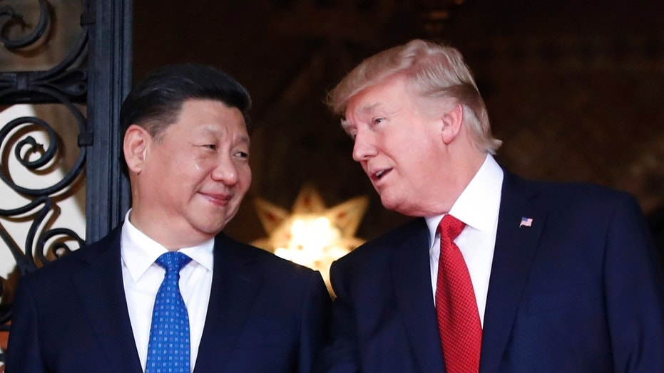 Chinese President Xi Jinping, left, smiles at U.S. President Donald Trump as they meet in Palm Beach, Fla., April 6, 2017.
