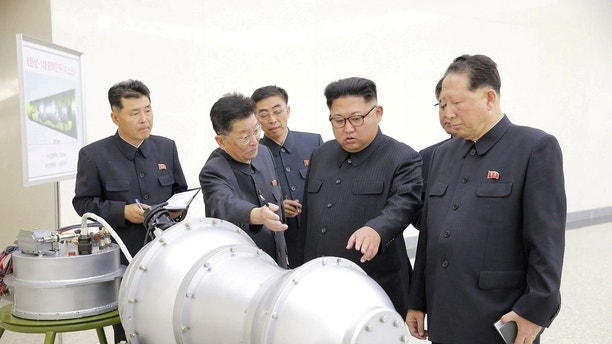 REFILE - ADDITIONAL INFORMATION North Korean leader Kim Jong Un provides guidance with Ri Hong Sop (2nd L) and Hong Sung Mu (R) on a nuclear weapons program in this undated photo released by North Korea's Korean Central News Agency (KCNA) in Pyongyang September 3, 2017.  KCNA via REUTERS    ATTENTION EDITORS - THIS PICTURE WAS PROVIDED BY A THIRD PARTY. REUTERS IS UNABLE TO INDEPENDENTLY VERIFY THE AUTHENTICITY, CONTENT, LOCATION OR DATE OF THIS IMAGE.  NOT FOR SALE FOR MARKETING OR ADVERTISING CAMPAIGNS. NO THIRD PARTY SALES. NOT FOR USE BY REUTERS THIRD PARTY DISTRIBUTORS. SOUTH KOREA OUT. NO COMMERCIAL OR EDITORIAL SALES IN SOUTH KOREA. THIS PICTURE IS DISTRIBUTED EXACTLY AS RECEIVED BY REUTERS, AS A SERVICE TO CLIENTS. - RC1326A8D0A0
