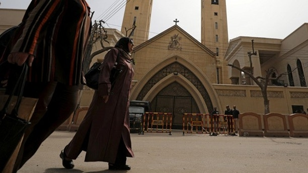 Women pass by the Coptic church that was bombed on Sunday in Tanta, Egypt, April 10, 2017. REUTERS/Mohamed Abd El Ghany - RTX34WJ3