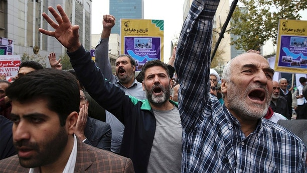 Demonstrators chant slogans during an annual rally marking the anniversary of the 1979 U.S. Embassy takeover in Tehran, Iran, Saturday, Nov. 4, 2017. Iran on Saturday displayed a surface-to-surface missile as part of events marking the anniversary of the 1979 U.S. Embassy takeover and hostage crisis amid uncertainty about its nuclear deal with world powers. (AP Photo/Vahid Salemi)