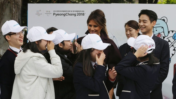 "U.S. first lady Melania Trump is greeted by South Korean middle school students as Choi Min-ho, a member of South Korean boy band Shinee, top right, watches during ""Girls Play 2!"" Initiative, an Olympic public diplomacy outreach campaign, at the U.S. Ambassador's Residence in Seoul, South Korea, Tuesday, Nov. 7, 2017. (AP Photo/Ahn Young-joon. Pool)"