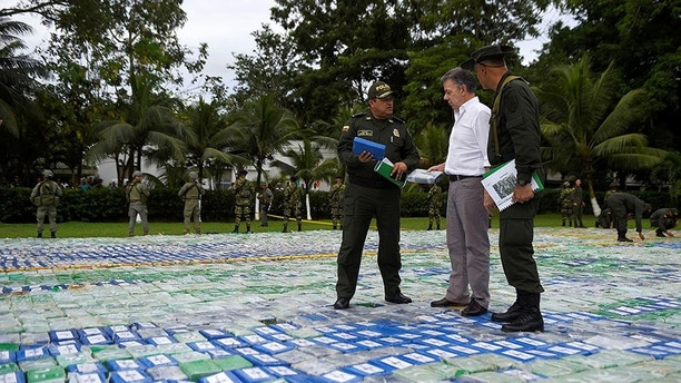 Colombia's President Juan Manuel Santos looks on after the seizure of more than 12 tons of cocaine in Apartado, Colombia November 8, 2017. Colombian Presidency/Handout via REUTERS    ATTENTION EDITORS -  THIS IMAGE HAS BEEN SUPPLIED BY A THIRD PARTY - RC1718165CB0