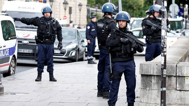 French gendarmes and police stand at the scene of a shooting incident near the Notre Dame Cathedral in Paris, France, June 6, 2017.  REUTERS/Charles Platiau - RC19CE105E00