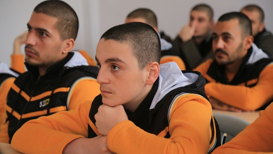 Participants watch their instructor at the Syrian Center for Anti-Extremist Ideology