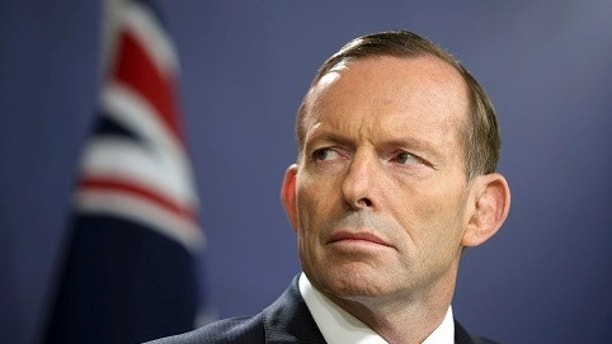 FILE - In this Sept. 19, 2014, file photo, former Australian Prime Minister Tony Abbott speaks during a press conference, in Sydney.  Australia's Prime Minister Malcolm Turnbull  confirmed Friday, Aug. 25, 2017,  that his predecessor and intra-party rival Abbott had once been too drunk to vote in Parliament, an incident that's been a poorly kept secret in political circles for eight years.(AP Photo/Rick Rycroft, File)