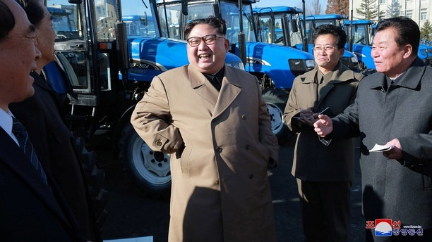 North Korean leader Kim Jong Un gives field guidance to the Kumsong Tractor Factory in this undated picture provided by KCNA in Pyongyang on November 15, 2017. KCNA via Reuters ATTENTION EDITORS - THIS IMAGE WAS PROVIDED BY A THIRD PARTY. REUTERS IS UNABLE TO INDEPENDENTLY VERIFY THIS IMAGE. SOUTH KOREA OUT. NO THIRD PARTY SALES. NOT FOR USE BY REUTERS THIRD PARTY DISTRIBUTORS - RC1D41C4D6D0