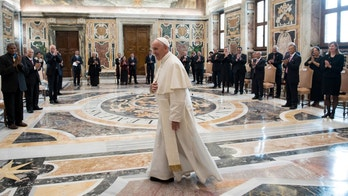 Pope Francis walks in the Clementine Hall after meeting with a delegation of Pacific leaders to discuss climate issues, at the Vatican, Saturday, Nov. 11, 2017. Francis met Saturday with a delegation of Pacific leaders and told them he shares their concerns about rising sea levels and increasingly intense storms that are threatening their small islands. (L'Osservatore Romano/Pool Photo via AP)