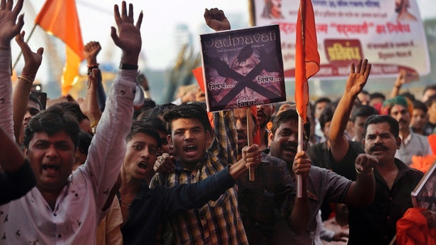 """Members of India's Rajput community shout slogans as they protest against the release of Bollywood film """"Padmavati"""" in Mumbai, India, Monday, Nov. 20, 2017. The film has been in trouble since the beginning of the year, with fringe groups in the western state of Rajasthan attacking the film's set, threatening to burn down theaters that show it and even physically attacking the director in January. A member of India's Hindu nationalist ruling party has offered a 100 million rupee ($1.5 million) reward to anyone who beheads the lead actress and the director of the yet-to-be released film over its alleged handling of the relationship between a Hindu queen and a Muslim ruler. (AP Photo/Rafiq Maqbool)"""
