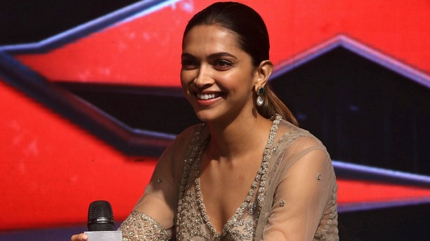 """Bollywood actress Deepika Padukone interacts with the media during a news conference promoting the upcoming film """"xXx: Return of Xander Cage"""" in Mumbai, India January 12, 2017. REUTERS/Shailesh Andrade - RC1C7813B2F0"""
