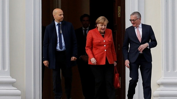 German Chancellor Angela Merkel leaves the meeting with President Frank-Walter Steinmeier after coalition government talks collapsed in Berlin, Germany, November 20, 2017. REUTERS/Axel Schmidt - RC1F135B43C0