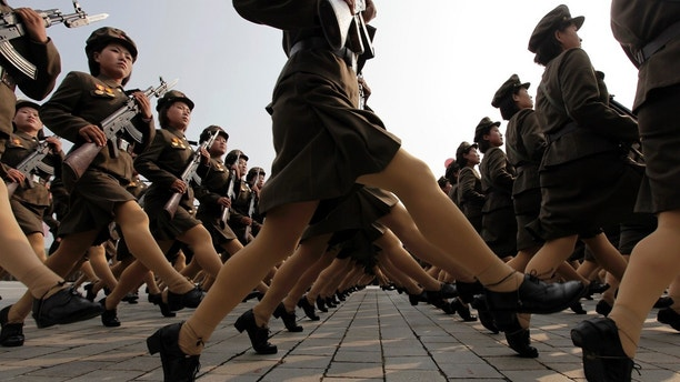 Female North Korean soldiers march during a military parade to commemorate the 65th anniversary of founding of the Workers' Party of Korea in Pyongyang October 10, 2010. Secretive North Korea's leader-in-waiting, the youngest son of ailing ruler Kim Jong-il, took centre stage during a massive military parade on Sunday, appearing live for the first time in public.      REUTERS/Petar Kujundzic  (NORTH KOREA - Tags: POLITICS MILITARY ANNIVERSARY IMAGES OF THE DAY) - GM1E6AA104D01