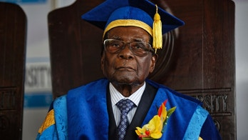 FILE - In this Friday Nov. 17, 2017 file photo, Zimbabwean President Robert Mugabe attends a graduation ceremony on the outskirts of Harare. (AP Photo/Ben Curtis, File)