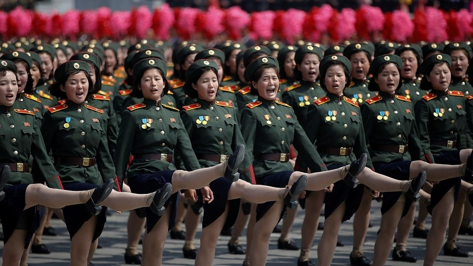 North Korean soldiers march during a military parade marking the 105th anniversary of the country's founding.