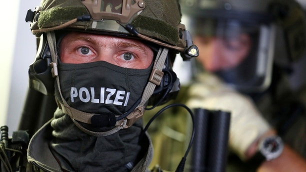 Members of the GSG 9 unit of Bundespolizei, Germany's federal police, are pictured during the opening of a new headquarters for special forces and anti-terror units in Berlin, Germany August 8, 2017. REUTERS/Hannibal Hanschke - RC1DBB46DD30