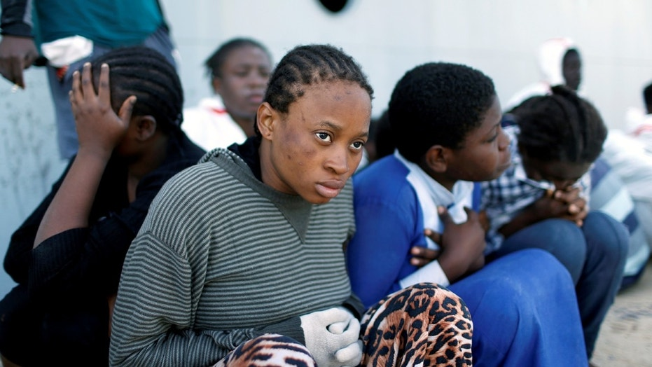 Migrants arrive at a naval base after being rescued by Libyan coast guards in Tripoli in November.