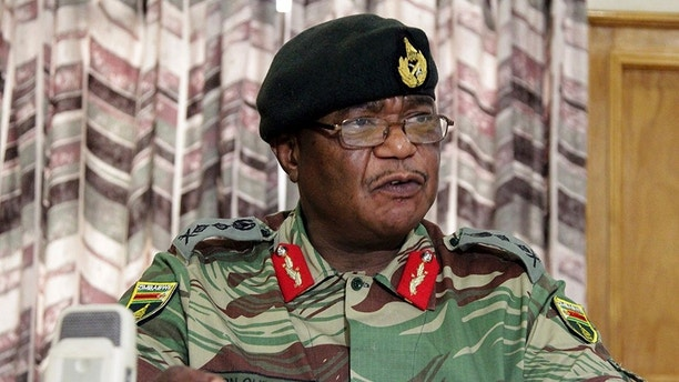 Zimbabwe's Army Commander, Constantino Chiwenga addresses a press conference in Harare, Monday, Nov. 13, 2017. The army commander Monday criticized the instability in the countryâ??s ruling party caused by President Robert Mugabe who last week fired a vice president. (AP Photo/Tsvangirayi Mukwazhi)