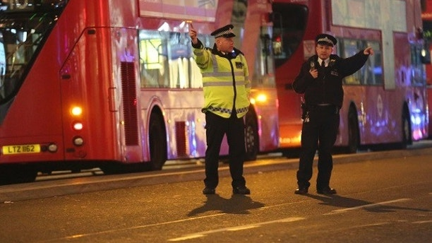 Police officers directing members of the public on Oxford Street in the west end of London after Oxford Circus station was evacuated Friday Nov. 24, 2017. British police said Friday they were responding to reports of an incident at Oxford Circus subway station, one of London's busiest. (Isabel Infantes/PA via AP)