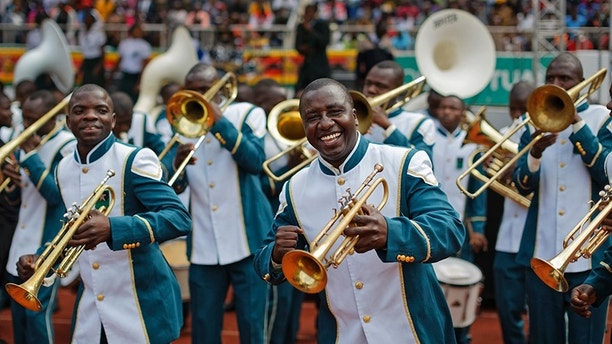 A member of the military band dances as they wait for Emmerson Mnangagwa's presidential inauguration ceremony in the capital Harare, Zimbabwe Friday, Nov. 24, 2017. Mnangagwa is being sworn in as Zimbabwe's president after Robert Mugabe resigned on Tuesday, ending his 37-year rule. (AP Photo/Ben Curtis)