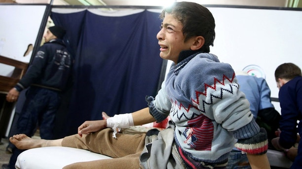 A wounded boy reacts in a hospital in Douma after an airstrike on the rebel-held town of Mesraba, in the rebel-held besieged town of Douma, eastern Ghouta in Damascus, Syria, November 26, 2017. REUTERS/Bassam Khabieh - RC122577E280