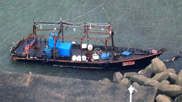 A wooden boat is moored at a nearby marina, in Yurihonjo, Akita prefecture, northern Japan, Friday, Nov. 24, 2017.   Japanese police are investigating eight men found on Japan's northern coast who say they are from North Korea and washed ashore after their boat broke down.  Akita prefectural police said Friday they found the men late Thursday after receiving a call that a group of suspicious men were standing around at the seaside in Yurihonjo town.  Police also found the wooden boat at the marina. (Kyodo News via AP)