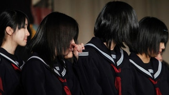 Graduates from Ogatsu Junior High School, affected by the March 11, 2011 earthquake and tsunami, react after the farewell party after their graduation ceremony in Ishinomaki, Miyagi prefecture March 10, 2012. Their graduation comes a day before the first-year anniversary of the March 11, 2011 earthquake and tsunami. REUTERS/Toru Hanai (JAPAN - Tags: ANNIVERSARY DISASTER EDUCATION) - GM1E83A1GN101