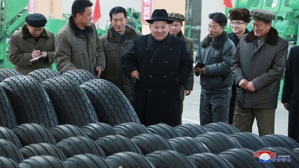 North Korea's leader Kim Jong Un inspects tires at a factory in this photo released by North Korea's Korean Central News Agency (KCNA) in Pyongyang December 3, 2017. KCNA/ via REUTERS ATTENTION EDITORS - THIS IMAGE WAS PROVIDED BY A THIRD PARTY. REUTERS IS UNABLE TO INDEPENDENTLY VERIFY THIS IMAGE. NO THIRD PARTY SALES. SOUTH KOREA OUT. - RC1C63480D10