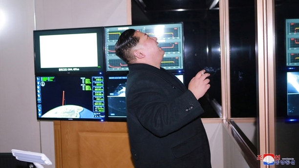 North Korea's leader Kim Jong Un is seen as the newly developed intercontinental ballistic rocket Hwasong-15's test was successfully launched, in this undated photo released by North Korea's Korean Central News Agency (KCNA) in Pyongyang November 30, 2017. REUTERS/KCNA ATTENTION EDITORS - THIS IMAGE WAS PROVIDED BY A THIRD PARTY. REUTERS IS UNABLE TO INDEPENDENTLY VERIFY THIS IMAGE. SOUTH KOREA OUT. NO THIRD PARTY SALES. NOT FOR USE BY REUTERS THIRD PARTY DISTRIBUTORS - RC1F2ACDE550
