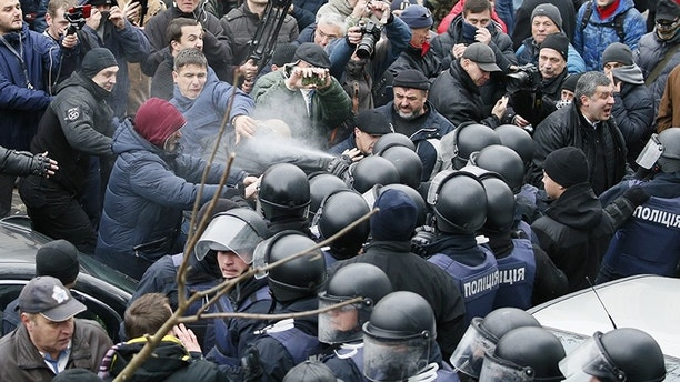 Police officers use tear gas against supporters of Georgian former President Mikheil Saakashvili during clashes in Kiev, Ukraine December 5, 2017. REUTERS/Gleb Garanich - UP1EDC50SZBJY