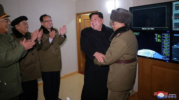 North Korea's leader Kim Jong Un is seen as the newly developed intercontinental ballistic rocket Hwasong-15's test was successfully launched, in this undated photo released by North Korea's Korean Central News Agency (KCNA) in Pyongyang November 30, 2017. REUTERS/KCNA ATTENTION EDITORS - THIS IMAGE WAS PROVIDED BY A THIRD PARTY. REUTERS IS UNABLE TO INDEPENDENTLY VERIFY THIS IMAGE. SOUTH KOREA OUT. NO THIRD PARTY SALES. NOT FOR USE BY REUTERS THIRD PARTY DISTRIBUTORS     TPX IMAGES OF THE DAY - RC13967A88D0