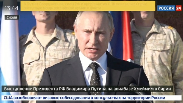 In this Monday, Dec. 11, 2017 frame grab made available by Russian Rossiya 24 TV Channel Russian President Vladimir Putin addresses to the troops at the Hemeimeem air base in Syria. Declaring a victory in Syria, Putin on Monday visited a Russian military air base in the country and announced a partial pullout of Russian forces from the Mideast nation. (Rossiya 24 TV Channel photo via AP)