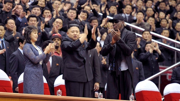 North Korean leader Kim Jong-Un (C), his wife Ri Sol-Ju (L) and former NBA basketball player Dennis Rodman clap during an exhibition basketball game in Pyongyang in this undated picture released by North Korea's KCNA news agency on March 1, 2013. KCNA reported that a mixed basketball game of visiting U.S. basketball players and North Korean players was held at Ryugyong Jong Ju Yong Gymnasium in Pyongyang on February 28, 2013.     REUTERS/KCNA (NORTH KOREA - Tags: POLITICS SPORT BASKETBALL IMAGES OF THE DAY)ATTENTION EDITORS - THIS PICTURE WAS PROVIDED BY A THIRD PARTY. REUTERS IS UNABLE TO INDEPENDENTLY VERIFY THE AUTHENTICITY, CONTENT, LOCATION OR DATE OF THIS IMAGE. THIS PICTURE IS DISTRIBUTED EXACTLY AS RECEIVED BY REUTERS, AS A SERVICE TO CLIENTS. QUALITY FROM SOURCE. NO THIRD PARTY SALES. NOT FOR USE BY REUTERS THIRD PARTY DISTRIBUTORS - GM1E9310XGV01