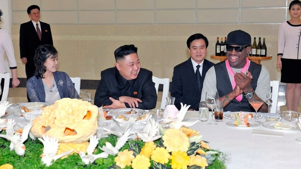 North Korean leader Kim Jong-Un (C), his wife Ri Sol-Ju (L) and former NBA basketball player Dennis Rodman (R) talk in Pyongyang in this undated picture released by North Korea's KCNA news agency on March 1, 2013. KCNA reported that a mixed basketball game of visiting U.S. basketball players and North Korean players was held at Ryugyong Jong Ju Yong Gymnasium in Pyongyang on February 28, 2013.     REUTERS/KCNA (NORTH KOREA - Tags: POLITICS SPORT TPX IMAGES OF THE DAY BASKETBALL) ATTENTION EDITORS - THIS PICTURE WAS PROVIDED BY A THIRD PARTY. REUTERS IS UNABLE TO INDEPENDENTLY VERIFY THE AUTHENTICITY, CONTENT, LOCATION OR DATE OF THIS IMAGE. THIS PICTURE IS DISTRIBUTED EXACTLY AS RECEIVED BY REUTERS, AS A SERVICE TO CLIENTS. QUALITY FROM SOURCE. NO THIRD PARTY SALES. NOT FOR USE BY REUTERS THIRD PARTY DISTRIBUTORS - GM1E9310VC201