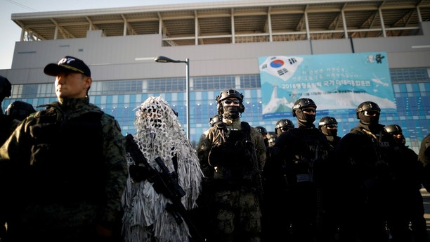 Members of Special Weapon and Tactics (SWAT) and the Special Warfare Command take part in a security drill ahead of the 2018 Pyeongchang Winter Olympic Games at the Olympic Stadium, the venue for the opening and closing ceremony in Pyeongchang, South Korea December 12, 2017.    REUTERS/Kim Hong-Ji - RC11996D68C0