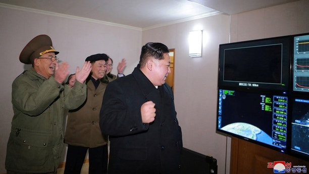 North Korea's leader Kim Jong Un is seen as the newly developed intercontinental ballistic rocket Hwasong-15's test was successfully launched, in this undated photo released by North Korea's Korean Central News Agency (KCNA) in Pyongyang November 30, 2017. REUTERS/KCNA ATTENTION EDITORS - THIS IMAGE WAS PROVIDED BY A THIRD PARTY. REUTERS IS UNABLE TO INDEPENDENTLY VERIFY THIS IMAGE. SOUTH KOREA OUT. NO THIRD PARTY SALES. NOT FOR USE BY REUTERS THIRD PARTY DISTRIBUTORS - RC1ECCC05940