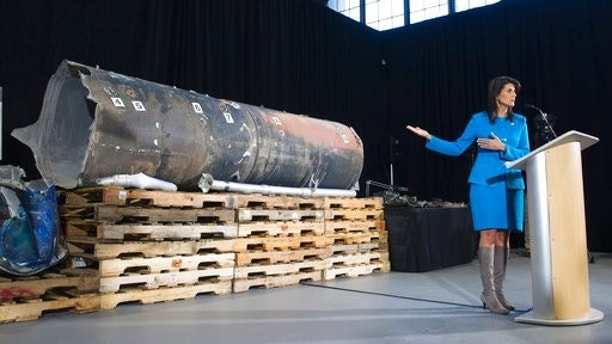 U.S. Ambassador to the U.N. Nikki Haley gestures as she speaks in front recovered segments of an Iranian rocket during a press briefing at Joint Base Anacostia-Bolling Thursday Dec. 14 2017 in Washington. Haley says