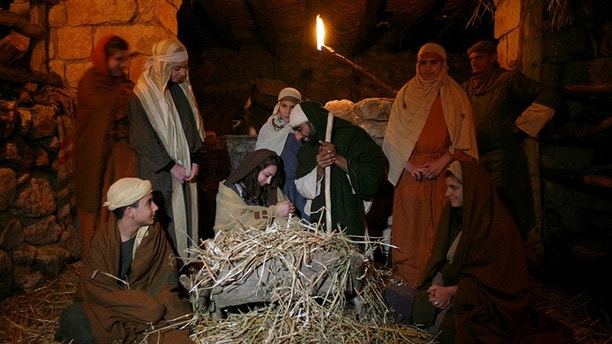 Actors re-enact a nativity scene at Nazareth Village in northern Israel December 21, 2009, ahead of Christmas. REUTERS/Gil Cohen Magen (ISRAEL - Tags: RELIGION) - GM1E5CM04B401