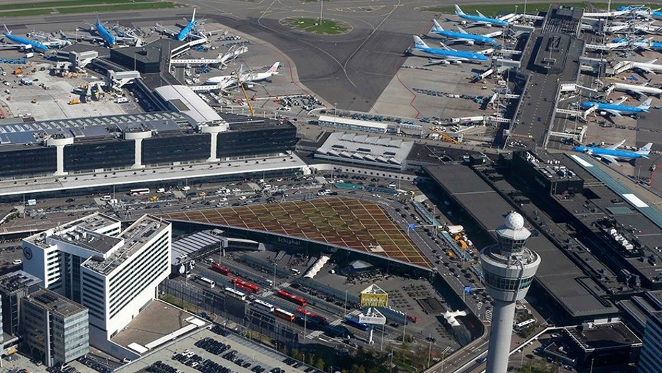 Police at Schiphol airport near Amsterdam shot and arrested a man who allegedly had a knife