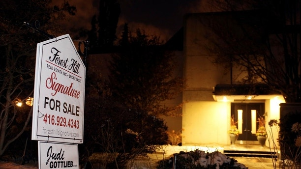 "A For Sale sign stands outside the home of billionaire founder of Canadian pharmaceutical firm Apotex Inc., Barry Sherman and his wife Honey, who were found dead under circumstances that police described as ""suspicious"" in Toronto, Ontario, Canada, December 15, 2017. REUTERS/Chris Helgren - RC1135AE2660"