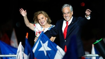 Chile's former President Sebastian Pinera and his wife Cecilia Morel wave to supporters as they celebrate Pinera's winning the presidential election runoff in Santiago, Chile, Sunday, Dec. 17, 2017. (AP Photo/Luis Hidalgo)